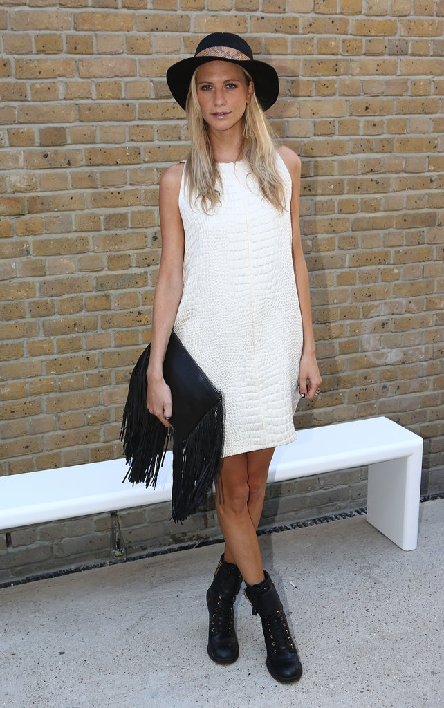 Poppy was snapped outside of the Zoe Jordan presentation in a LWD from the designer. She toughened up the sweet shift dress with a pair of black Tory Burch boots, a wide-brimmed hat by Zadig & Voltaire, and a fringe bag by Barbara Boner.