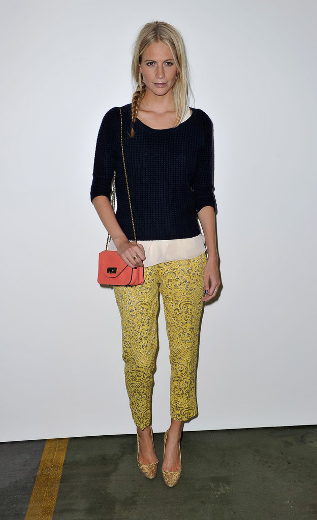 Poppy Delevingne wore a Paul Smith sweater over a Rag & Bone top, sparkly Dolce & Gabbana trousers, gold Manolo Blahnik heels and a bright Chloe bag at House of Holland.