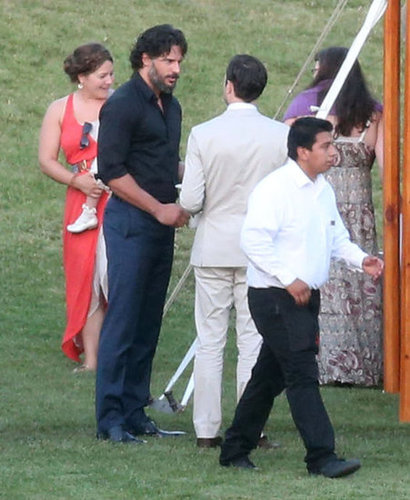 Joe Manganiello chatted with guests at Cobie Smulders and Taran Killam's ranch-style wedding in Solvang, CA, in September 2012.