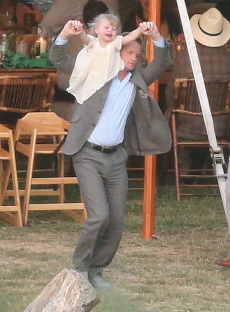 In September 2012, Neil Patrick Harris had fun with his daughter, Harper Burtka-Harris, at his How I Met Your Mother costars Cobie Smulders and Taran Killam's wedding in Solvang, CA.