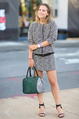 Geometric-print skirt suiting was offset by an emerald-hued duffel bag and easy sandals. Source: Greg Kessler