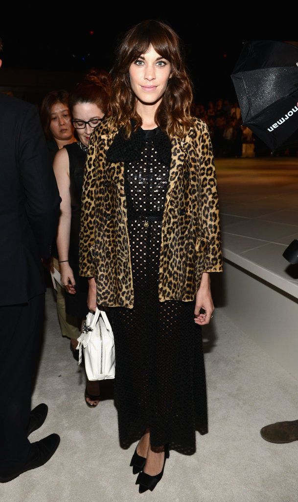 Alexa Chung mixed an exotic leopard-printed overcoat with one of Marc Jacobs's black Fall 2012 dresses. Her bow-adorned flats completed the look.