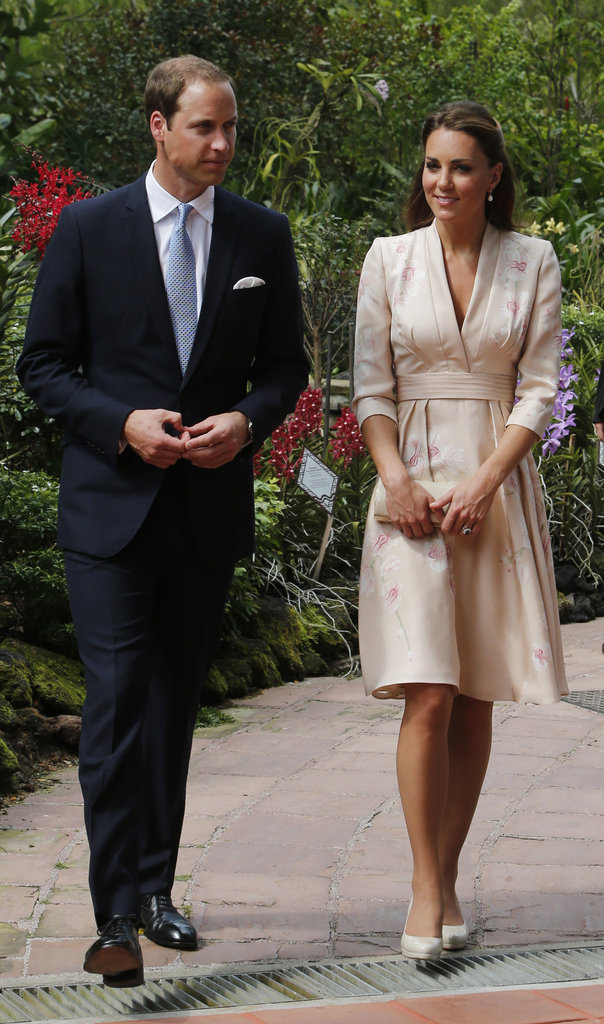 Kate Middleton looked radiant in a soft floral-print kimono dress by Jenny Packham — the orchids on her dress went perfectly with the Singapore Botanic Gardens scenery.