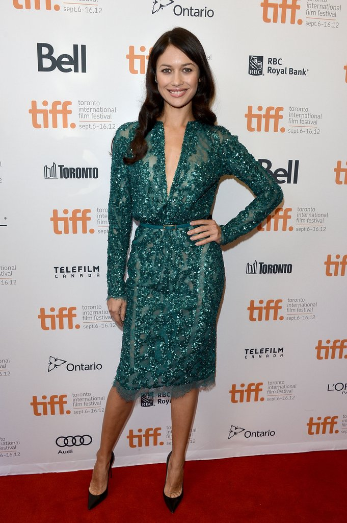 Rachel's costar Olga Kurylenko complemented her look with another green Elie Saab creation, this one superembellished and a bit more cocktail-hour-wearable.