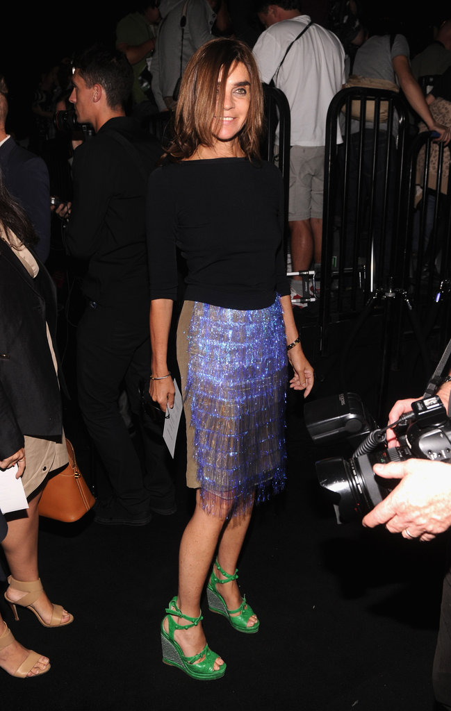 Carine Roitfeld stepped out of her all-black uniform and went for all-out whimsical in a bright fringed pencil skirt and electric green wedge sandals.