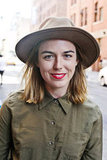 For a balanced look, try mixing the masculine (buttoned-up shirt and wide-brimmed hat) with the feminine (red lipstick).  Photo by Caroline Voagen Nelson