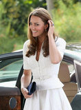 Kate Middleton wore a white dress with a jacket in Singapore.