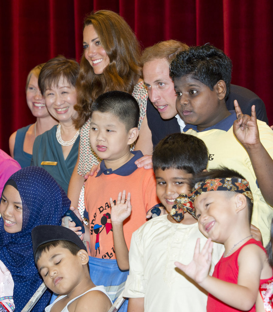 Will and Kate posed with a group of adorable children as they visited the Rainbow Centre on day two of the Diamond Jubilee tour of the Asia Pacific.