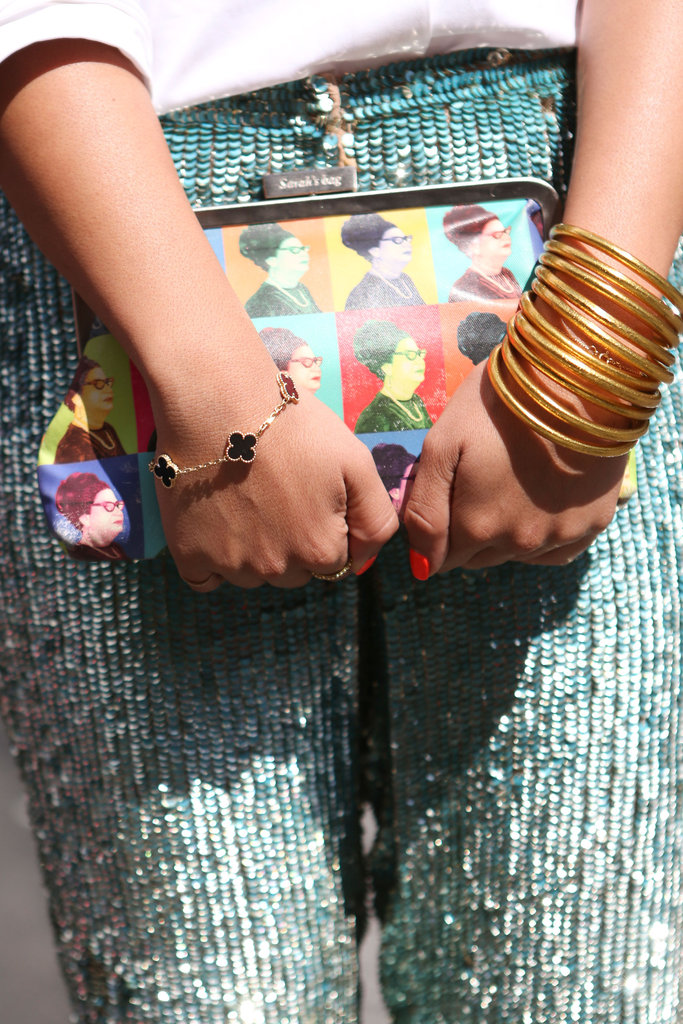 Photo-print, sequins, and an armful of bangles added up to a major accessory statement.