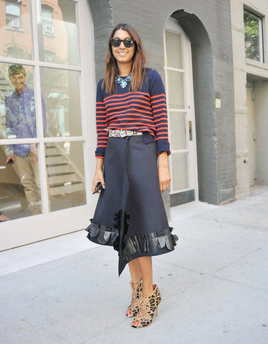 An architectural wrap skirt meets a classic striped sweater in this effortlessly on-trend mix.