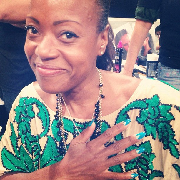 Designer Tracy Reese got the same nail art as her models did: a triangular, half-moon manicure.