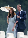 Kate Middleton shaded herself under an umbrella while visiting the Kranji War Memorial in Singapore with Prince William.
