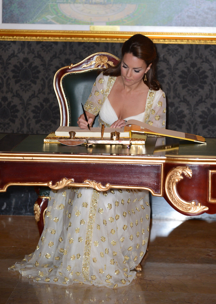 Kate Middleton took a seat at a desk.