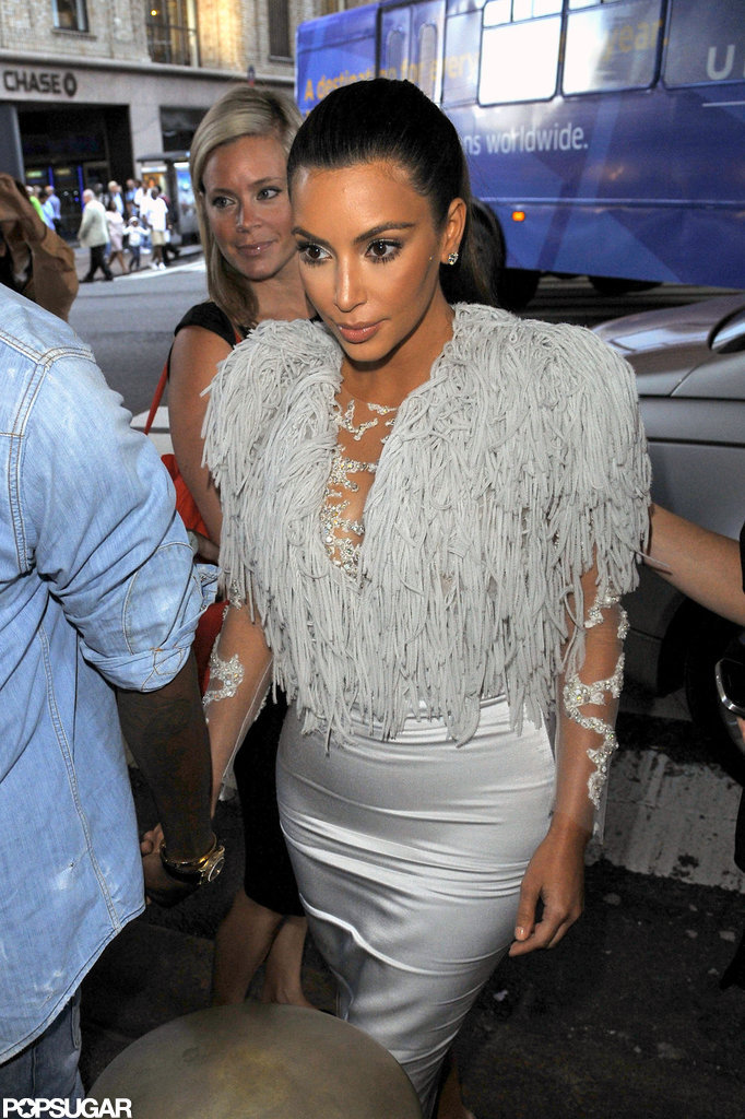 Kim Kardashian held hands with Kanye West.
