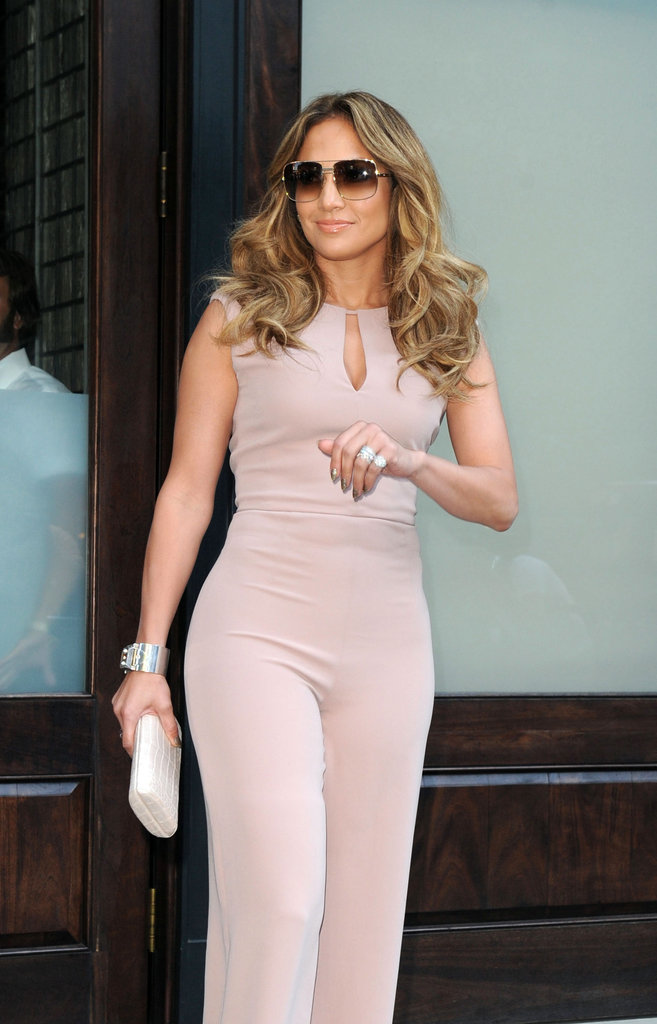 Jennifer Lopez showed off her curves in a light pink jumpsuit in NYC.