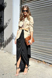 Olivia Palermo perfected easy Fall elegance in a draped maxi skirt and a belted military jacket.