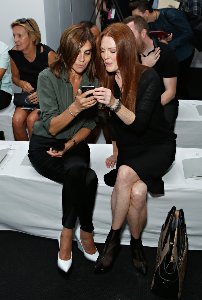 Carine Roitfeld and Julianne Moore shared a moment (and an iPhone) preshow at Reed Krakoff.