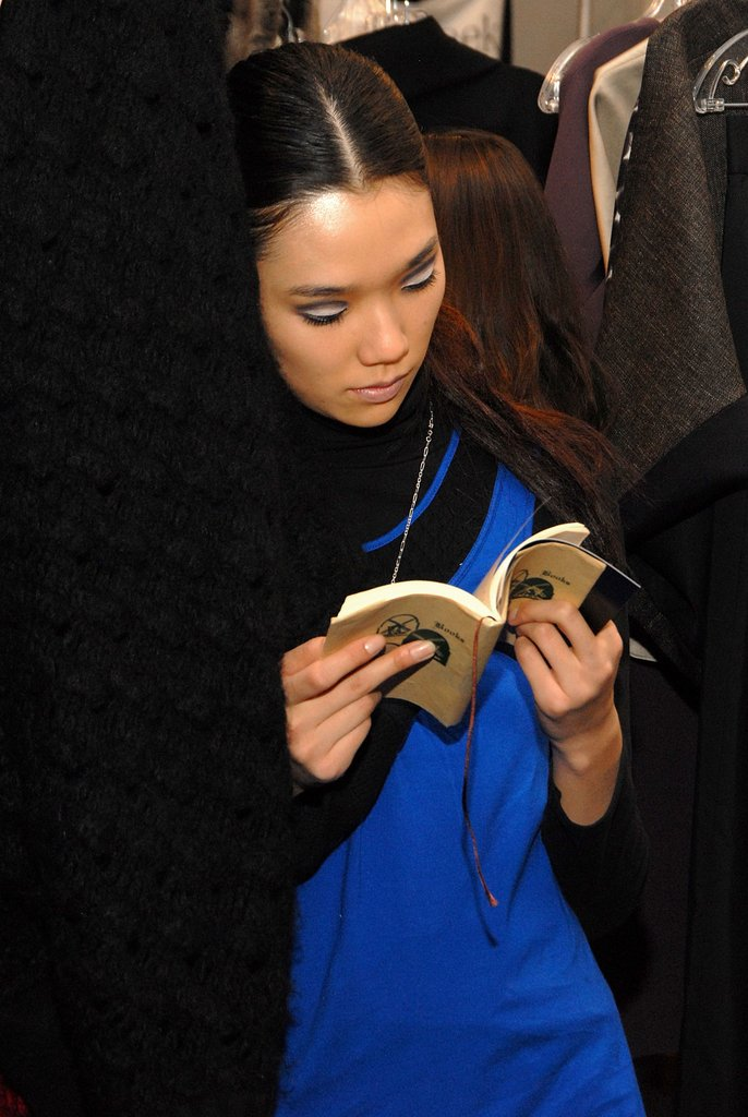 A Lyn Devon model read prior to the designer's Fall 2007 show during Mercedes-Benz Fashion Week.