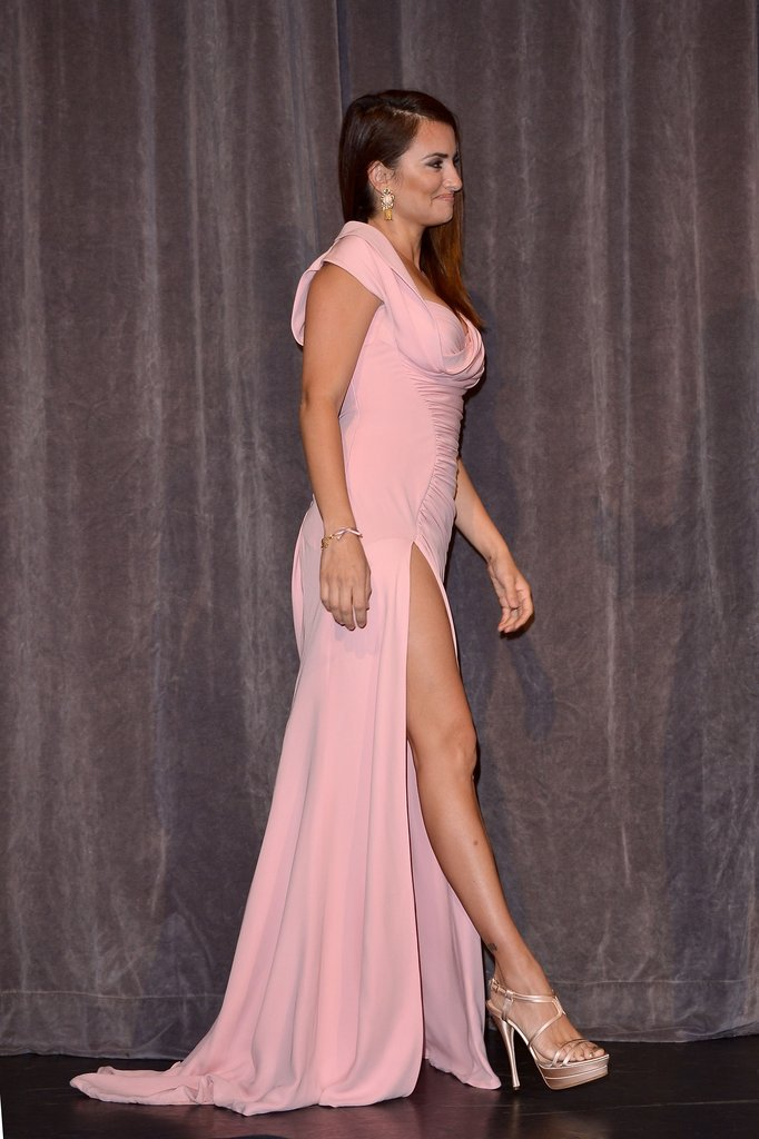 Penélope Cruz wore a sexy pink Atelier Versace gown with a thigh-high slit to the Twice Born Toronto Film Festival premiere in September 2012.