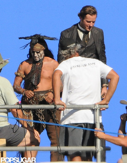 Shirtless Johnny Depp filmed with Armie Hammer.