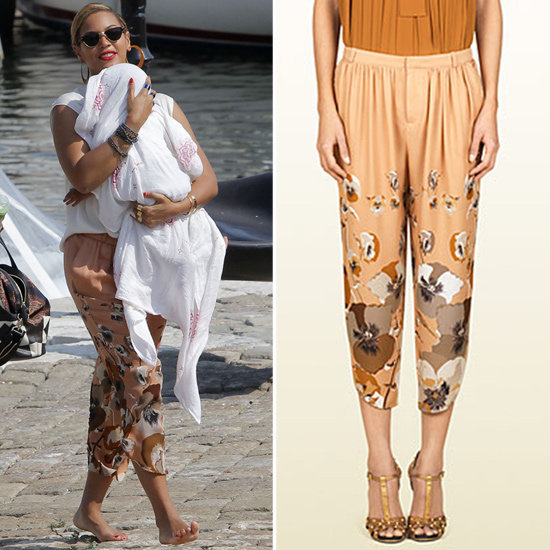 Beyoncé looked picture-perfect in Saint-Barts carrying baby Blue Ivy and working a pair of silky floral Gucci trousers. Shop the exact pair here.