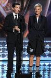 Television Academy chairman Bruce Rosenblum stood beside a strangely clad Ellen DeGeneres on stage.