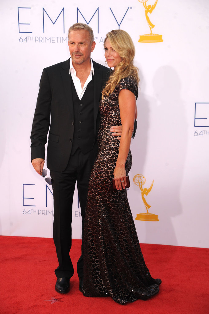 After walking the red carpet with his wife, Christine Baumgartner, Hatfields & McCoys actor Kevin Costner took home the Emmy for his role in the miniseries.