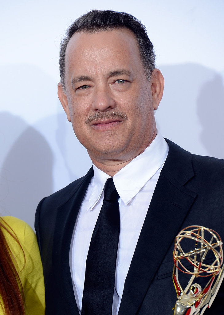 Tom Hanks held up his Emmy for the miniseries Game Change.