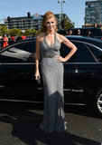 Connie Britton, who adopted son Yoby last year, arrived at the Emmys in a beaded halter dress.
