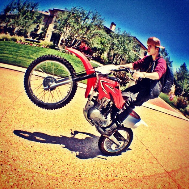 Justin Bieber showed off his motorcycle tricks.  Source: Instagram user justinbieber