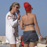 Kate Moss chatted with her friend in Ibiza.