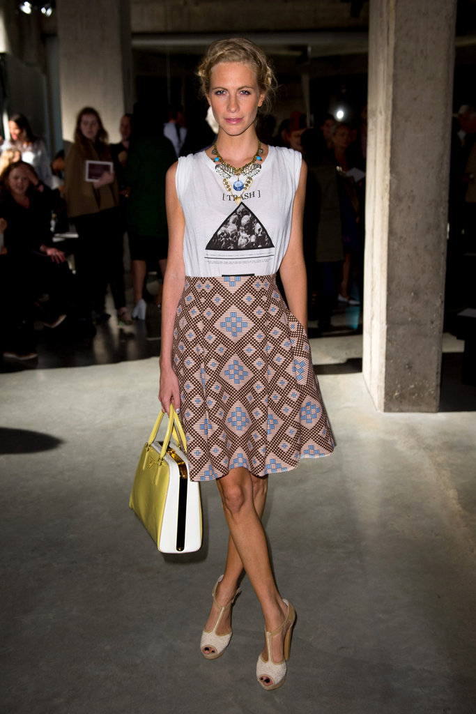 Poppy wore a Jonathan Saunders skirt for the designer's runway show on day three. She paired the look with a cool logo tee, Lulu Frost statement necklace, and Aldo heels.