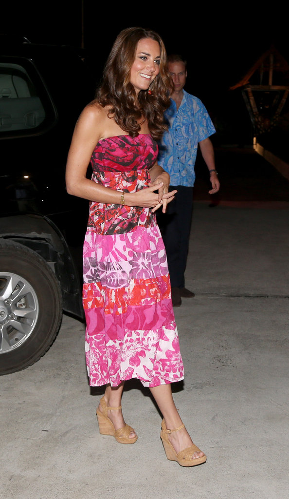 Her nude Stuart Weitzman wedge sandals complemented the batik-print dress with an overt summery feel.