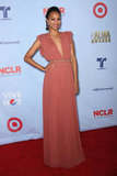 Zoe Saldana selected a dark coral Gucci gown with a deep neckline and feminine pleats.