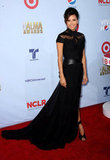 Eva Longoria played host for the evening in a dark, ultraglamorous Monique Lhuillier gown.