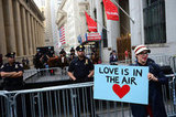 """A woman in New York held a sign that read """"Love is in the air."""""""
