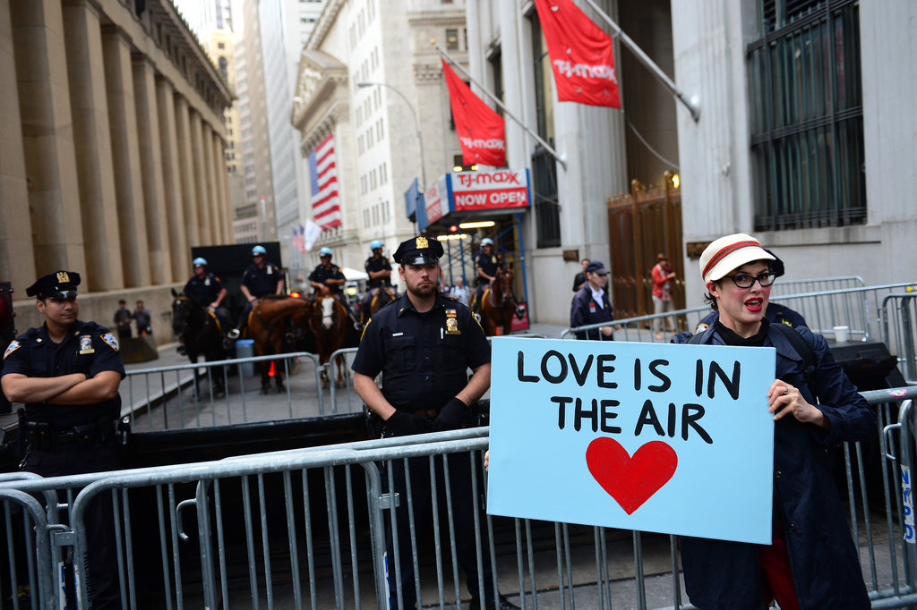 "A woman in New York held a sign that read ""Love is in the air."""