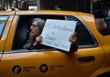 This lady in New York held her Occupy sign out the taxi window.