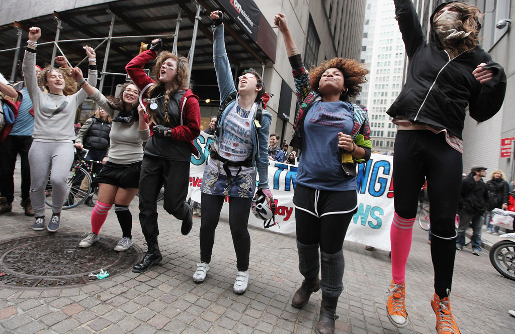 "A group of female protesters jumped together outside of the New York Stock Exchange as a part of ""Spring training"" ahead of the May Day strike."