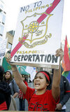 A Filipino woman used her sign to demand fair rights for immigrants during the May Day protests in New York.