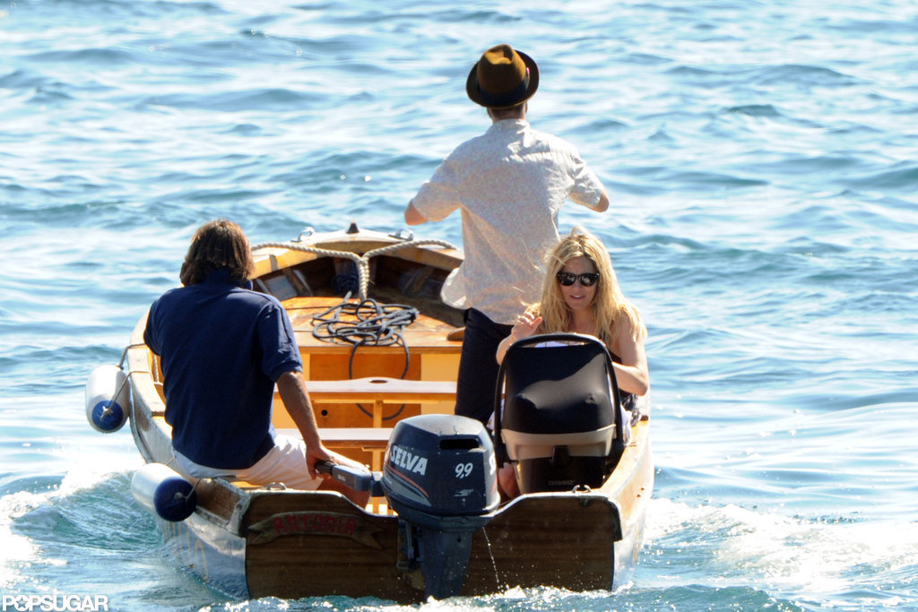 Tom Sturridge and Sienna Miller boarded a small boat in Positano.