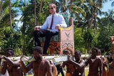 Prince William was carried on an elevated chair in Tuvalu.