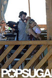 Sienna Miller held baby Marlowe tight with Tom Sturridge nearby for a family getaway to Positano.