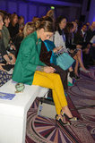 Olivia Palermo wore a green blazer to Anya Hindmarch.
