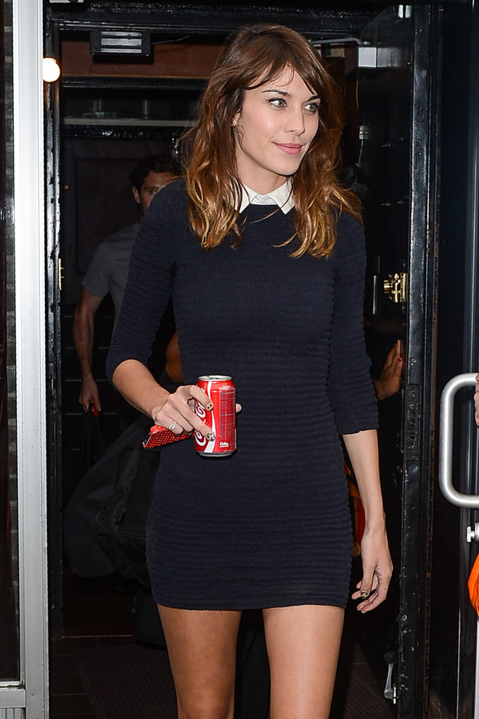 Alexa Chung's white collar added charm to her Carven X Petit Bateau minidress — and a striking color contrast to its navy hue.