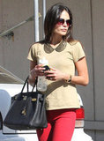 Jordana Brewster offset a basic t-shirt and gave the illusion of a collar with a collar-style statement necklace.