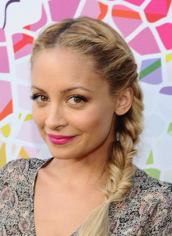 Her hot-pink lips and sweet French braids showed off her playful side at an event in 2011.