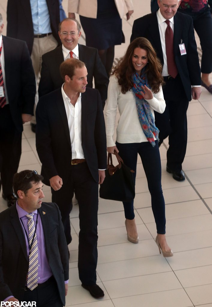 Kate Middleton changed into a pair of pants with a sweater and scarf to travel back to London with Prince William.
