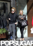 Kate Moss carried a large black purse while shopping with her friend James Brown.