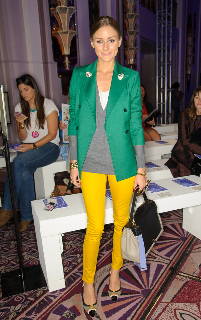 Olivia took colorblocking to chic heights in the front row of Anya Hindmarch's show at LFW. Adding a brilliant double-breasted blazer to standout yellow skinny jeans, Olivia made a bold statement but stuck to classic silhouettes. 8761684